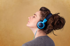 Young woman with headphones listening to music with copy space Stock Image
