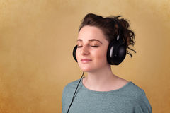 Young woman with headphones listening to music with copy space Stock Photography