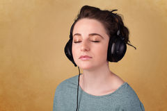 Young woman with headphones listening to music with copy space Stock Photo