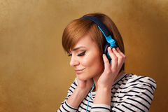Young woman with headphones listening to music with copy space Stock Images