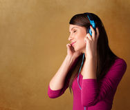 Young woman with headphones listening to music with copy space Royalty Free Stock Images