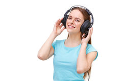 Young woman with headphones listening to music and dancing Stock Photography