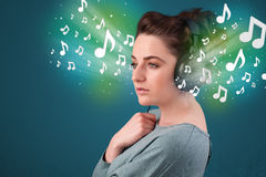 Young woman with headphones listening to music Royalty Free Stock Photo