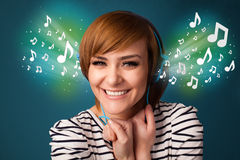 Young woman with headphones listening to music Stock Photo