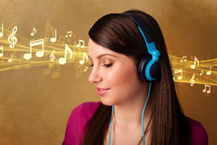 Young woman with headphones listening to music Royalty Free Stock Image