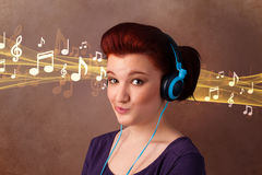Young woman with headphones listening to music Stock Image
