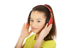 Young woman with headphones listening to music. Royalty Free Stock Images