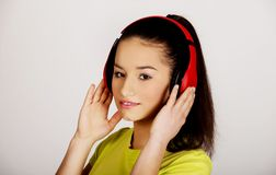 Young woman with headphones listening to music. Stock Images