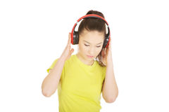 Young woman with headphones listening to music. Royalty Free Stock Photos