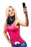 Young woman with headphones and mobile phone Royalty Free Stock Photography