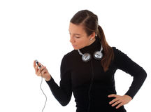 Young woman with headphones and mp3 player Stock Images