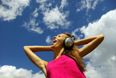 Young woman with headphones outdoors Royalty Free Stock Image