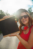 Young Woman With Headphones Outdoors Royalty Free Stock Photography