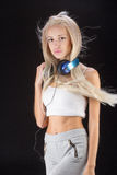 Young woman with headphones and phone Royalty Free Stock Images