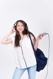 Young woman in headphones singing songs on a white background. Very young Stock Photo