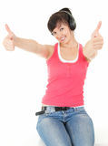 Young woman with headphones with thumbs up Royalty Free Stock Photography