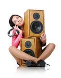 Young woman with headphones and two speaker Royalty Free Stock Image
