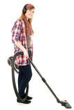 Young woman with headphones and a vacuum cleaner Stock Photo