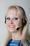 young woman with headset Royalty Free Stock Photo