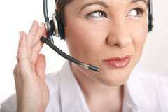 Young woman with headset has problems to understand the caller Stock Image