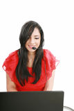 Young Woman with a headset at hotline. Royalty Free Stock Photo