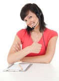 Young woman with headset keeping thumb up Stock Image