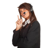Young woman in headset pointing Stock Photo