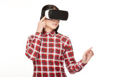 Young woman in headset of VR spending time in cyberspace. Stock Images