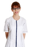 Young woman in healthcare worker uniform Stock Images