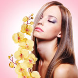 Young woman with healthy clean skin of face. Beautiful young woman with healthy clean skin of face with flowers stock images