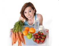 Young woman with healthy fruit tray and water Stock Image