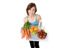 Young woman with healthy fruit tray and water Royalty Free Stock Image