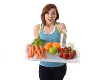 Young woman with healthy fruit tray and water Stock Photography
