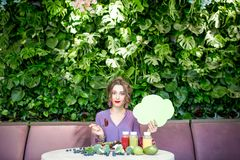 Woman with healthy food and thoughtful bubble royalty free stock image