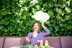 Woman with healthy food and thoughtful bubble royalty free stock photography