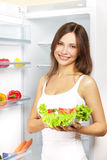 Young woman with healthy salad. Royalty Free Stock Photography