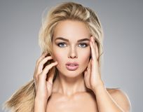 Young Woman with healthy skin of a face. Portrait of  Young Woman with healthy skin of a face. Attractive female with long light straight  hairs and brown make Stock Image