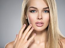 Young Woman with healthy skin of a face. Portrait of  Young Woman with healthy skin of a face. Attractive female with long light straight  hairs and brown make Stock Photography
