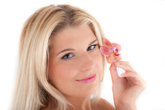 Young woman with healthy skin and flower Royalty Free Stock Images