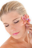 Young woman with healthy skin and flower Stock Photography