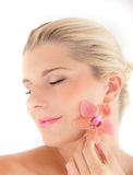 Young woman with healthy skin and flower Stock Images