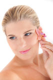 Young woman with healthy skin and flower Stock Photo