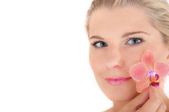 Young woman with healthy skin and flower Royalty Free Stock Photography
