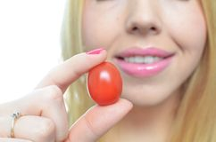 Young woman with healthy tomato Royalty Free Stock Photography