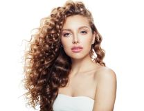 Young woman with healthy wavy hair and clear skin isolated on white royalty free stock photography