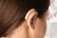 Young woman with hearing aid. Closeup view royalty free stock image