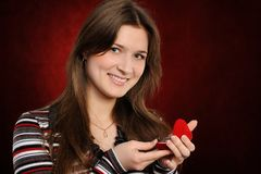 Young woman with a heart gift Royalty Free Stock Image