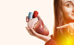 Young woman with heart in hand Stock Photo