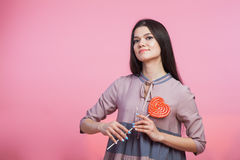 Young woman with heart lollipop on stick Royalty Free Stock Photo