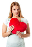 Young woman with a heart pillow in her hands - Valentines day concept. Stock Image